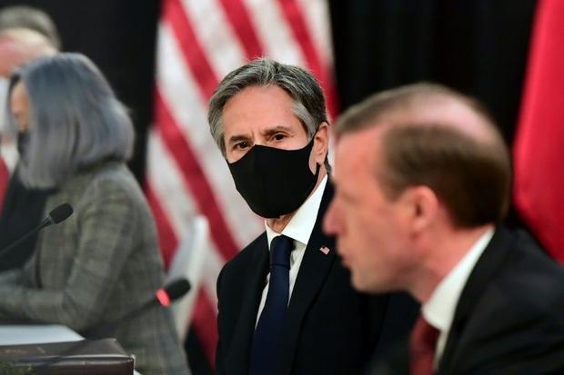 US National Security Advisor Jake Sullivan (R) speaks as US Secretary of State Antony Blinken (C) lo...